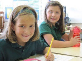 Изображение - Льготы при поступлении в школу first-graders-anna-garlick-left-and-becca-danapilis-start-work-on-a-classroom-assignment-on-their-first-day-of-school-2010-at-st-monicas-41651e23dbf78541-267x200